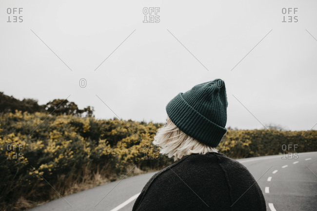UK- Scotland- Isle of Skye- rear view of young woman on country road
