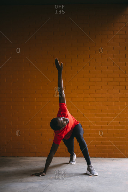 Young sportive man doing fitness exercise outdoors