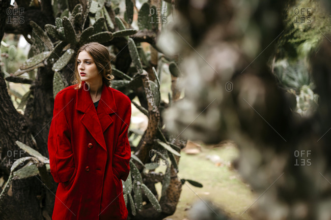 Woman with red coat in a park