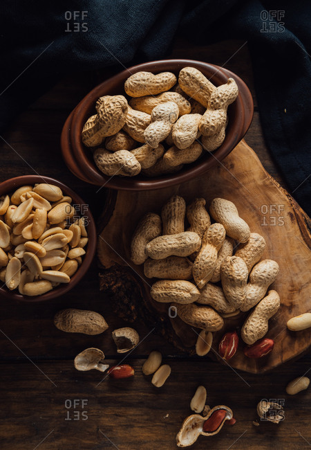 Group of peanuts on wooden boards