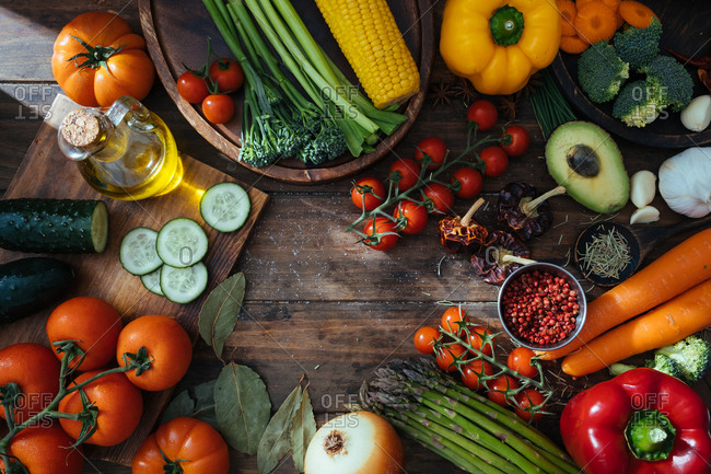Variety of fresh healthy food consisting of tasty fresh vegetables berries and herbs on wooden rustic table