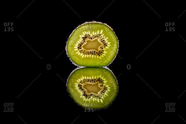 Half of fresh kiwi with seeds