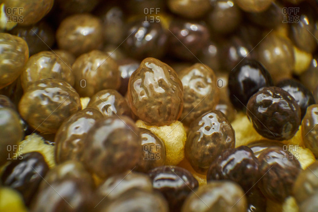 Closeup wet seeds of delicious ripe papaya inside cut fruit on summer day