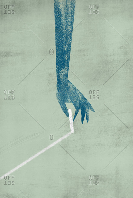 Isolated elegant hand of woman draws a line underground with a piece of chalk