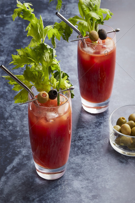 Two Bloody Mary Glasses with Olives and metal straws