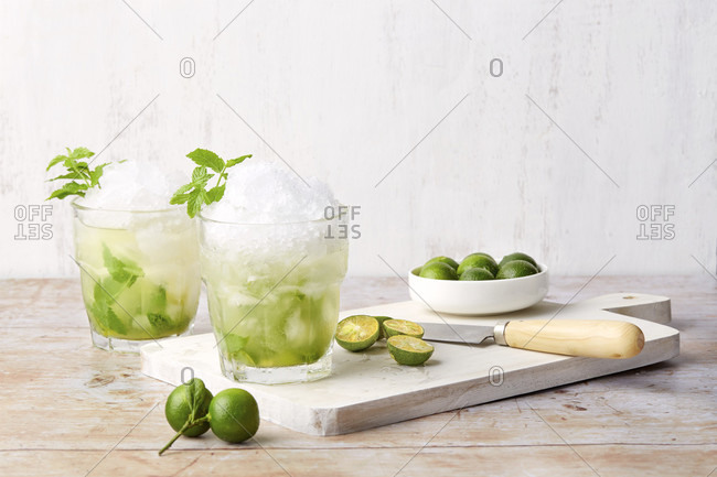 Two Calamansi Mojitos with crushed ice and lime