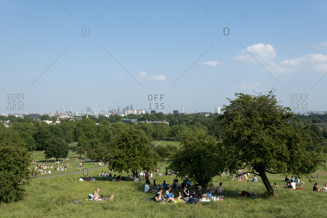 London, United Kingdom - July 6, 2013: People relaxing in the park at Primrose Hill in London