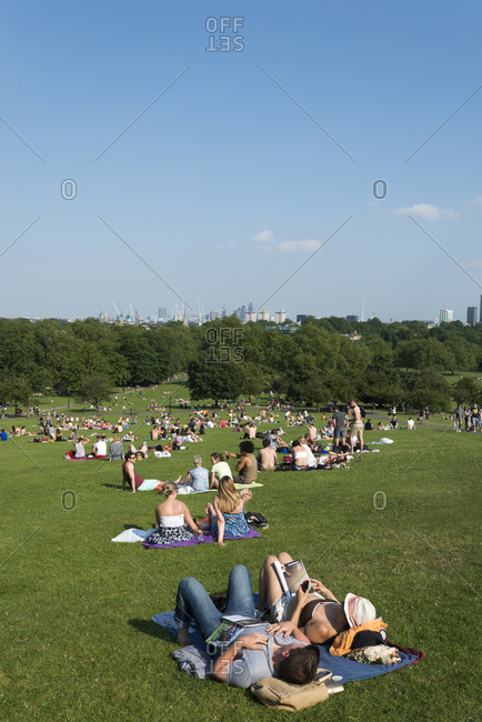 London, United Kingdom - July 6, 2013: People relaxing in the sunshine at Primrose Hill in London