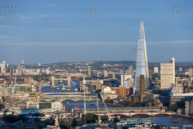 London, United Kingdom - August 21, 2015: Overlooking London and the Thames river from the top of Centre Point tower with view of The Shard, The Tate Modern and Tower Bridge