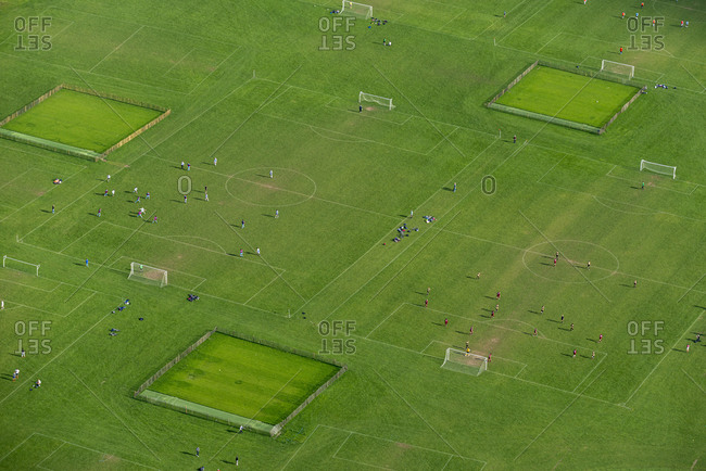 An aerial view of a green football pitch in London