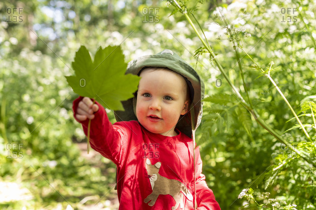 A toddler explores nature with wide eyed wonderment