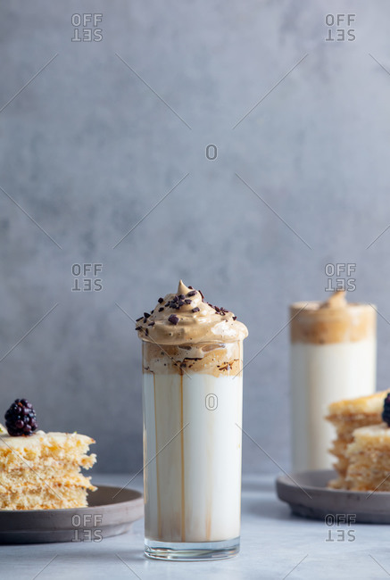 Dalgona coffee and cakes on a grey background