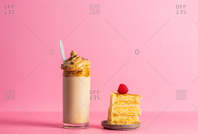 Dalgona coffee and cake on a pink background