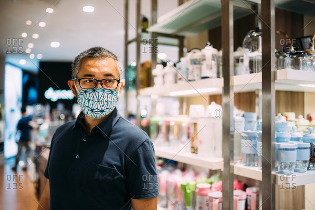 Asian man in a store wearing a facemask