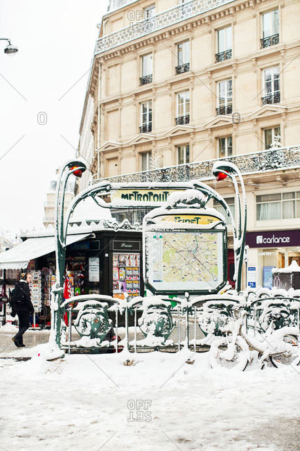 Paris, France - February 7, 2018: Snow covered city scene in downtown Paris
