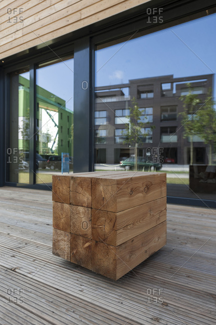 Wood as building material in front of a wooden house, IBA Hamburg, Germany