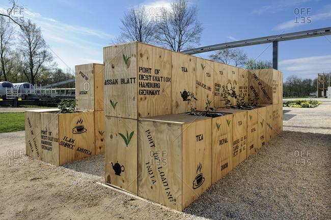 April 29, 2013: Tea chests as decoration and seating, IGS International Garden Show, Wilhelmsburg, Hamburg, Germany
