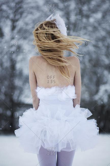 Ballerina freezing in the snow