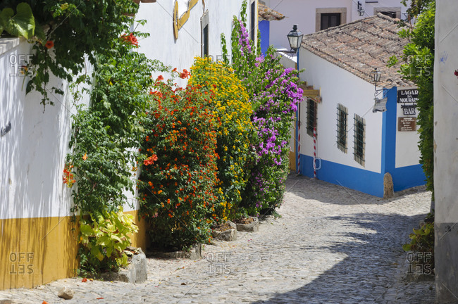August 22, 2012: Alley in a colorful neighborhood in Portugal