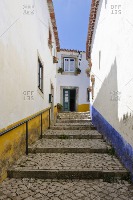 August 22, 2012: Alley in medieval Obidos, Portugal