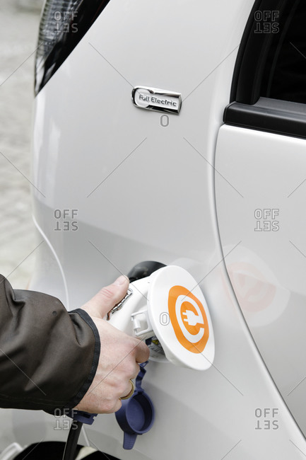 February 14, 2011: First series-produced, pure electric car in Germany, Citroen C-ZERO AIRDREAM at a charging station, charging, electromobility, electric car, Hamburg, Germany
