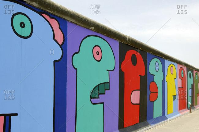 July 2, 2010: Artwork of Thierry Noir, Berlin Wall, East Side Gallery, Muehlenstrasse, Friedrichshain, Ostbahnhof, Berlin, Germany