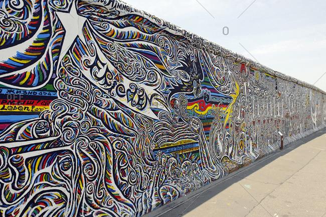 July 2, 2010: Artwork of Schamil Gimajev, Berlin Wall, East Side Gallery, Muehlenstrasse, Friedrichshain, Ostbahnhof, Berlin, Germany