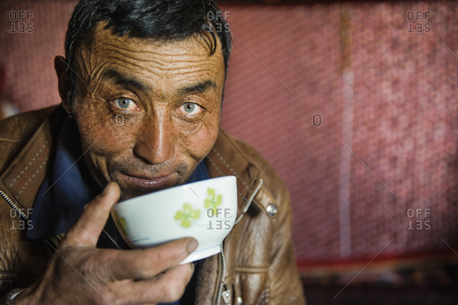 Uighur man with emerald green eyes in remote Xinjiang