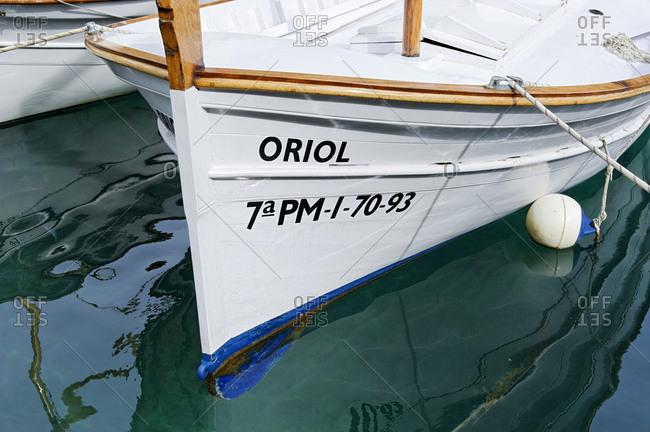 February 23, 2010: White fishing boats in the bay, Cala Figuera, Maritime, Majorca, Balearic Islands, Spain
