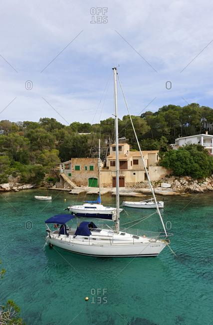 February 23, 2010: Sailing yacht in the bay, Cala Figuera, Mallorca, Balearic Islands, Spain