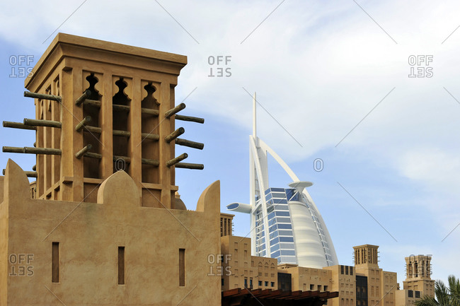 January 31, 2010: Top of the Burj Al Arab behind wind towers of the Souk Madinat, Jumeirah, Dubai, United Arab Emirates, Middle East