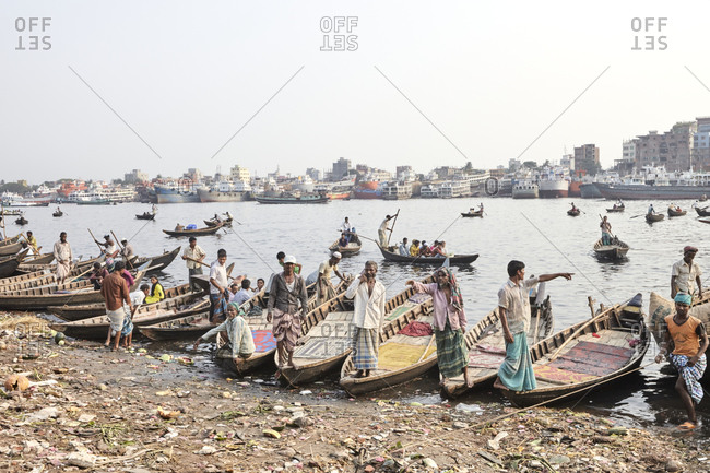 Dhaka, Bangladesh - April 27, 2013: Boatmen waiting for passengers at Sadarghat Boat Terminal