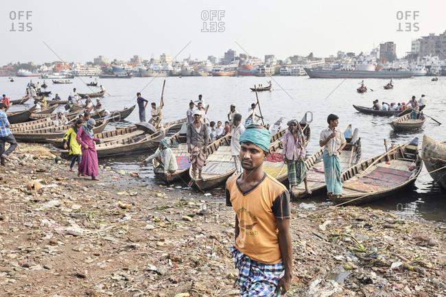 Dhaka, Bangladesh - April 27, 2013: Boatmen waiting for passengers along the shore at the Sadarghat Boat Terminal