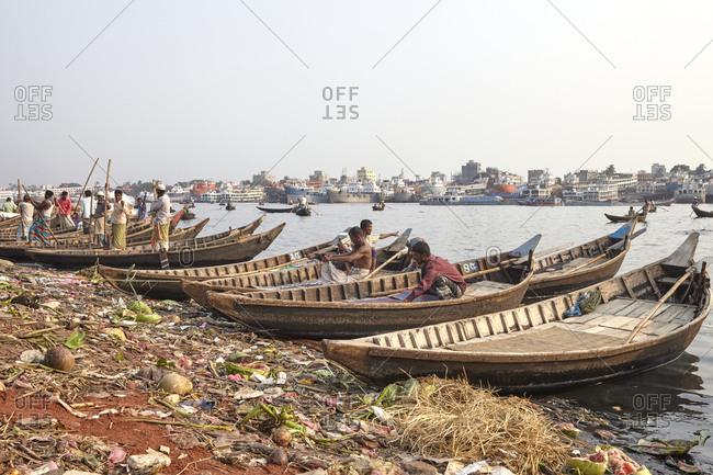 Dhaka, Bangladesh - April 27, 2013: Boatmen at Sadarghat Boat Terminal waiting for passengers