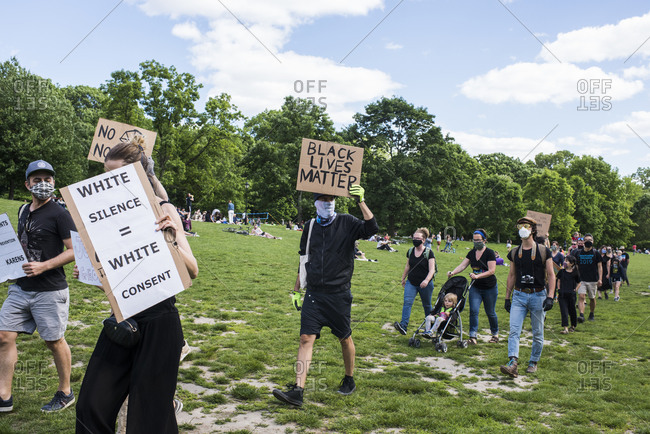 New York City, New York, USA - May 31, 2020: Peaceful protest demanding justice for the death of George Floyd, through Prospect Park, organized by Park Slope families, Brooklyn , New York City, USA.