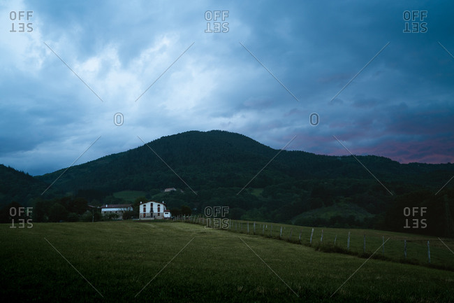 White farm in the Basque Country with dramatic clouds in the background