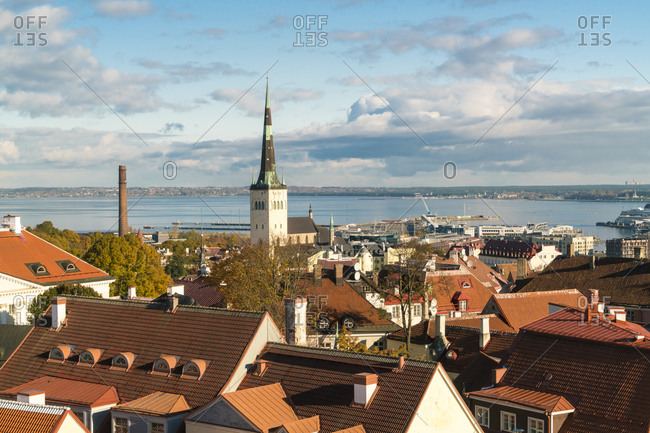 Estonia, Harju County, Tallinn - October 21, 2017: View of the old town with St Olaf's church tower and the Baltic sea