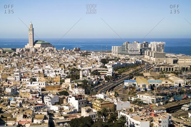 Casablanca, Casablanca-Settat, Morocco - November 13, 2017: Elevated view of Casablanca city with Grand mosque and the Atlantic Ocean