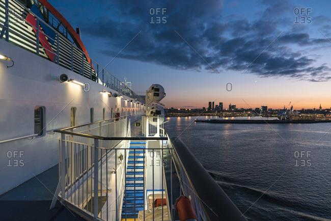 Tallinn, Harju County, Estonia - October 23, 2017: Ferry entering the harbor of Tallinn by sunset