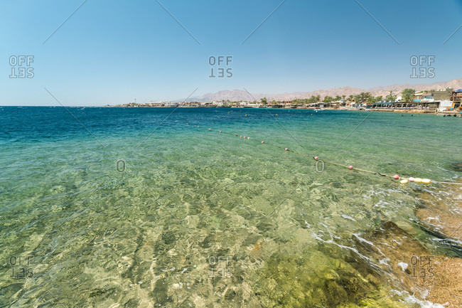 Dahab, South Sinai Governorate, Egypt - April 16, 2017: Red Sea Dahab blue water with mountainy in the background