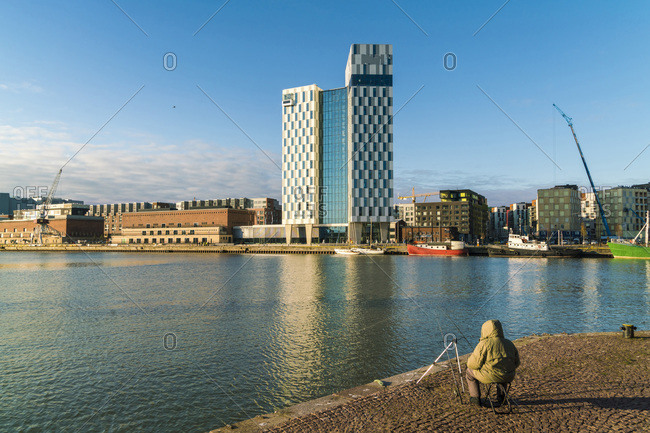 Helsinki, Finland - October 23, 2017: The commercial industrial West harbor in Helsinki with modern hotels