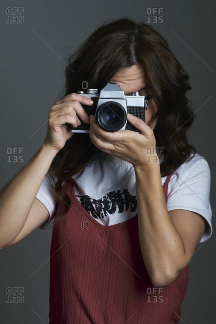 Person taking a photo in the studio
