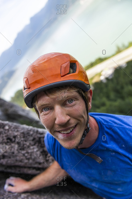 Portrait of climber looking nice with helmet on a multipitch climb