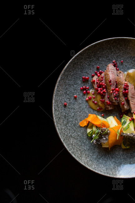 Beautifully laid out salad on a plate with meat