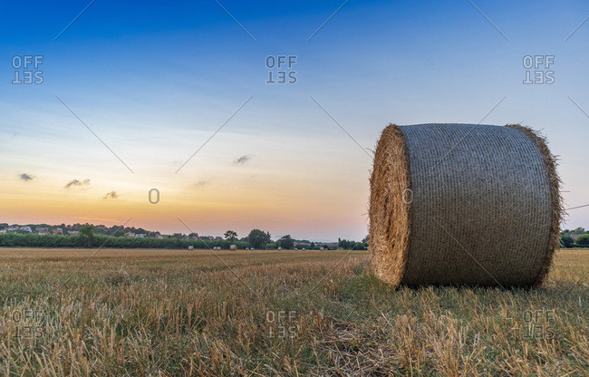 Rural village with straw bales at sunset on the Mediterranean coast