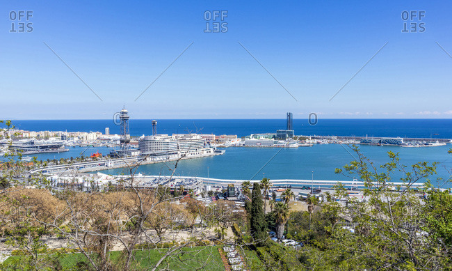 Barcelona, Spain - April 4, 2019: Skyline of Barcelona from Montjuic mountain overlooking the port