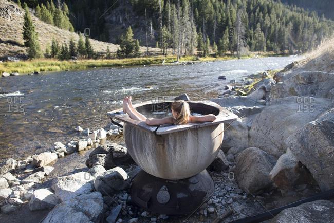 A woman enjoying a dip in the hot springs, Idaho