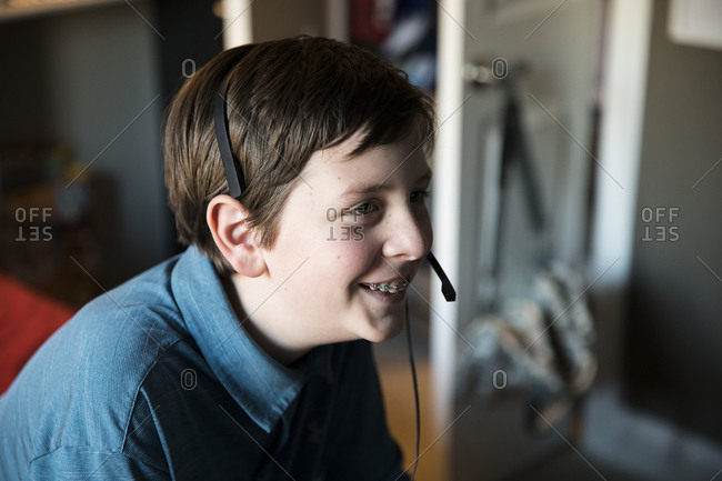 Side View of Smiling Teen With Braces Wearing Gaming Headset