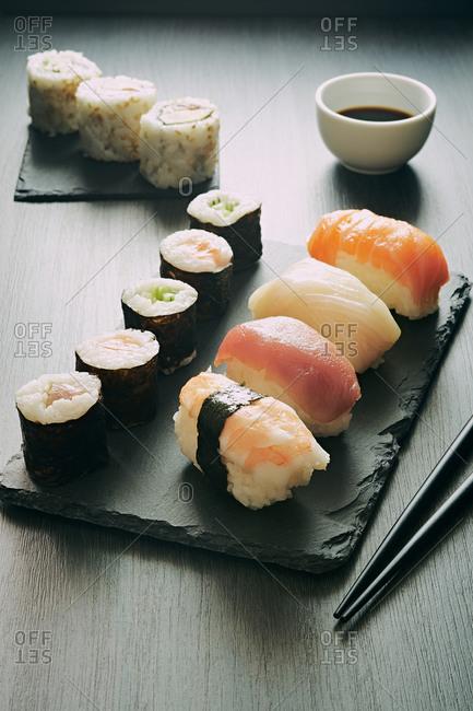 Sushi set and sashimi rolls served