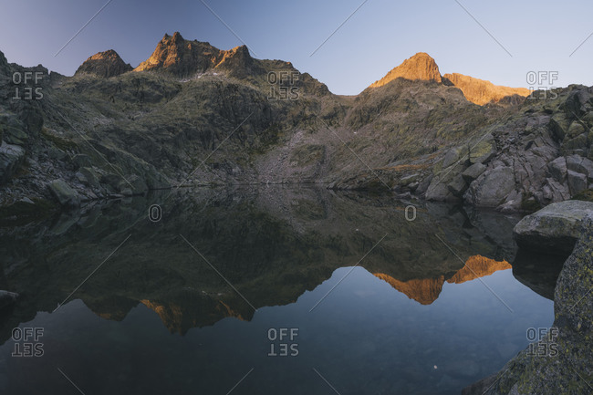 Granite peaks reflections over the lake at Sierra de Gredos, Spain